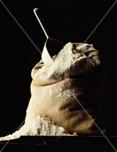 A sack of flour against a black background
