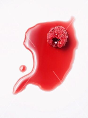 A raspberry in raspberry juice