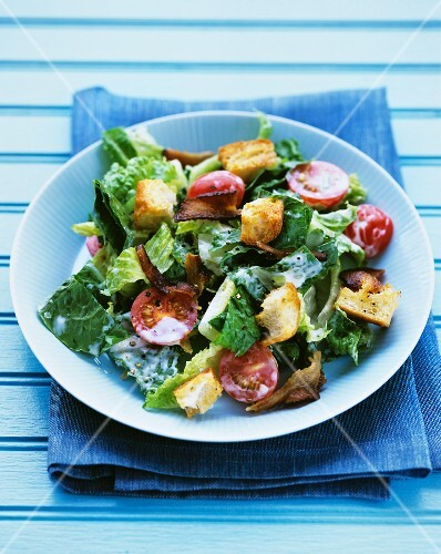 Romaine lettuce with cherry tomatoes, bacon and croutons
