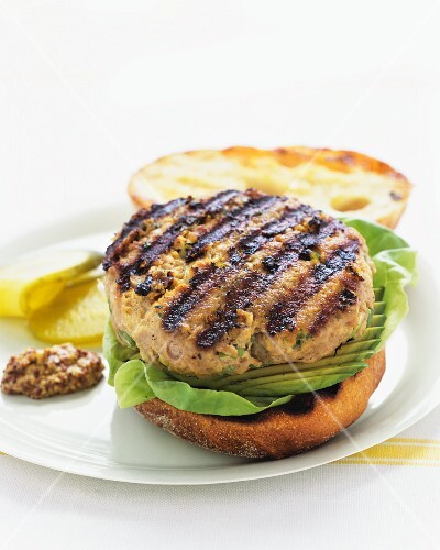 A barbecued hamburger with avocado
