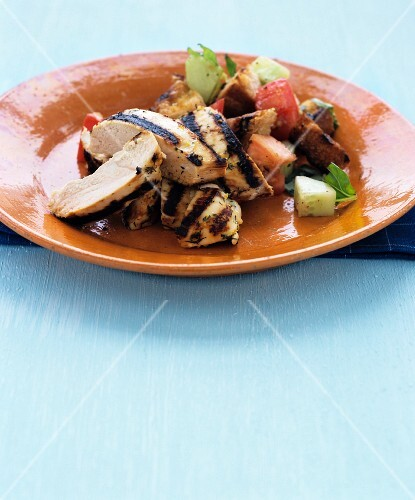 Grilled chicken breast with bread salad