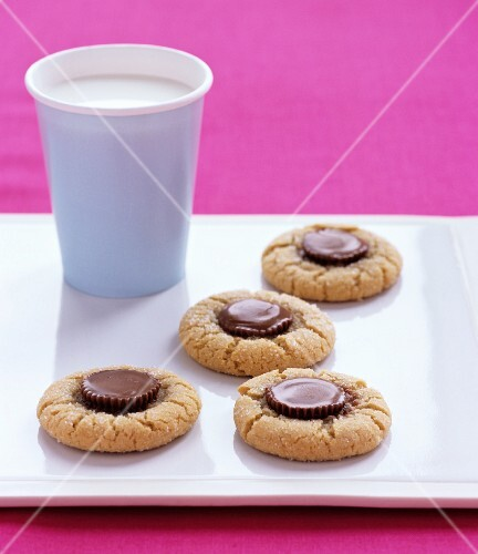 Biscuits with chocolate and a cup of milk