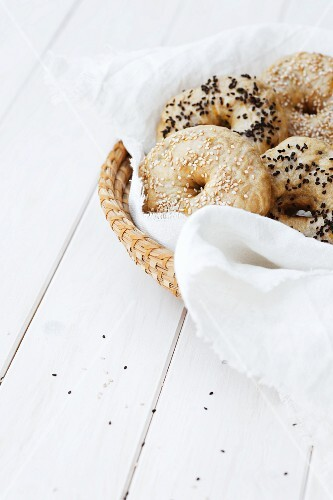 Assorted bagels in a bread basket