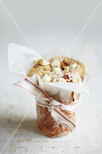 A blondie wrapped in grease-proof paper with a ribbon
