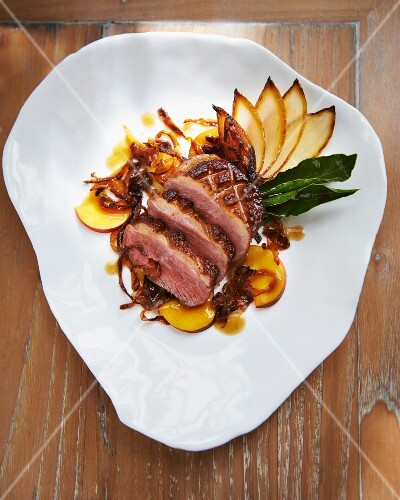 Duck breast with peach and caramelised onions
