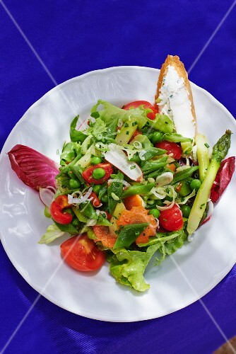 Vegetable salad with sugar snap peas and peas