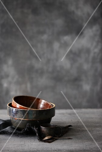 Empty ceramic dishes, an old measuring cup and a spoon