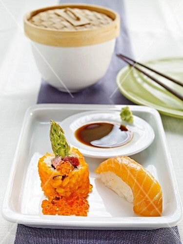 Nigiri sushi with salmon and maki with asparagus and caviar