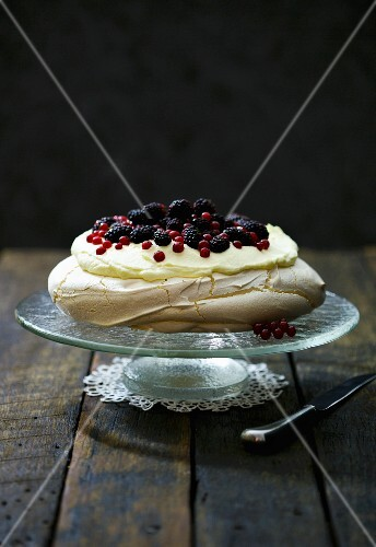 Pavlova with white chocolate cream and berries