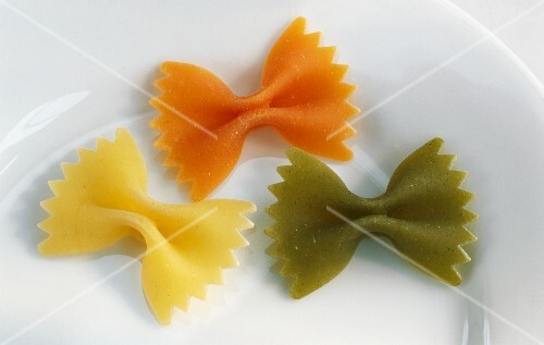 Three pieces of farfalle pasta on a plate