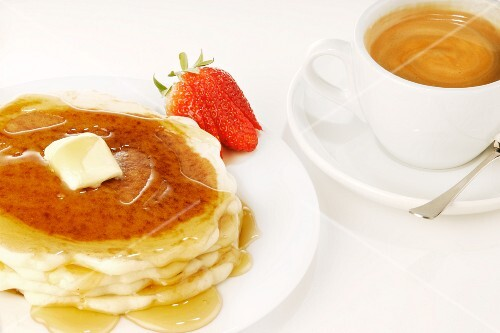 Pancakes with Butter and Maple Syrup and a Cup of Coffee
