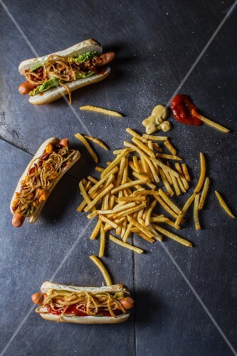 Hot dogs and french fries on the floor