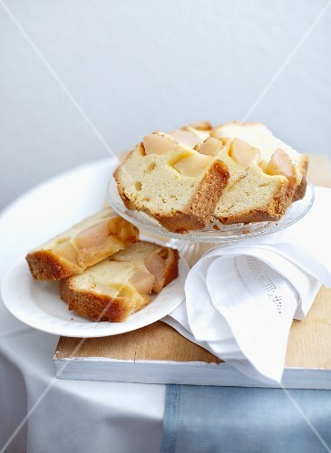 A few slices of upside-down pear cake on cake plates