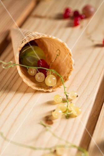 Redcurrants and whitecurrants, with gooseberries in a wafer cone