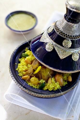 Lamb tagine with pistachios, pine nuts, turmeric and raisins (Tunisia)