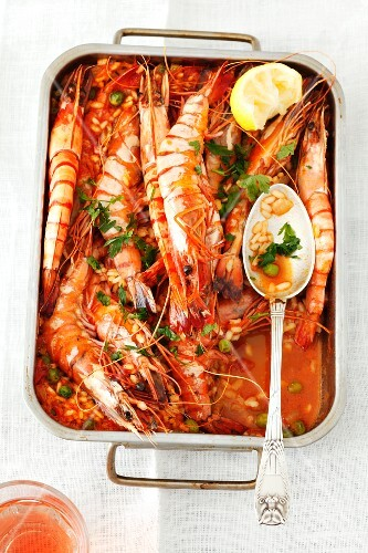 Baked king prawns on tomato rice