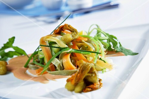 Vegetables and pasta salad with cheese sauce