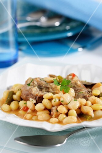 Pork cheeks with stewed beans