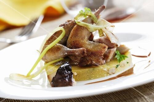 Roast quail on polenta with mushroom stock