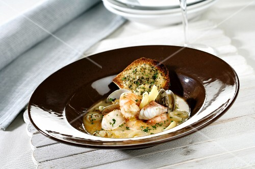 Fish soup with parmesan crisps (Spain)