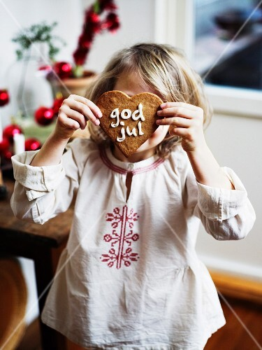 Girl holding Christmas gingerbread