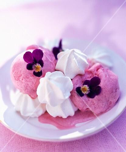 Raspberry ice cream with mini meringues and pansies