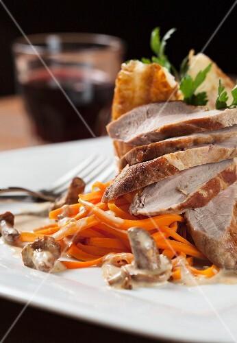 Roast pork with carrots and a mushroom sauce