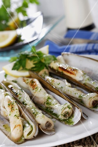 Grilled razor clams with a garlic and parsley sauce