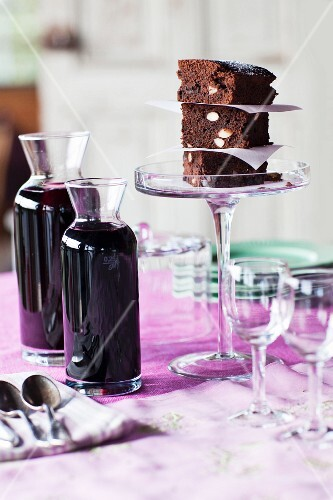 Close up of cake and wine carafes on table