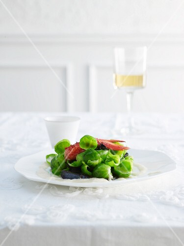 Truffled Brussels sprout leaves with lobster on a port wine foam