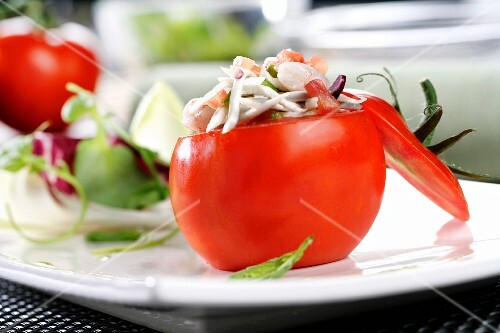Tomato filled with seafood salad