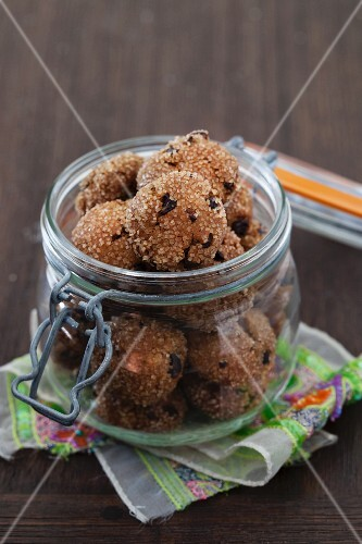 Apricot ginger bites with cocoa nibs in glass jar