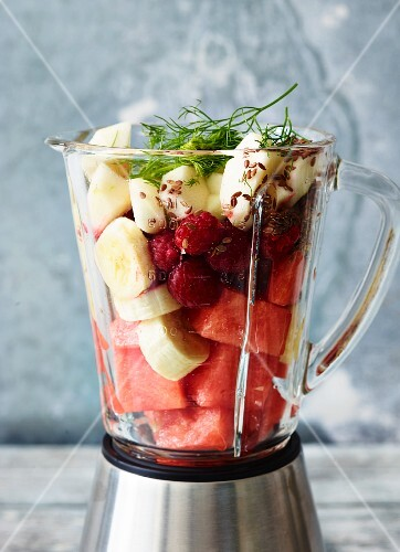 Ingredients for chilli & melon smoothie and for pomegranate & fennel smoothie, in a blender