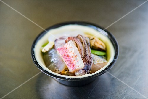 Assorted fresh fish and seafood in a bowl