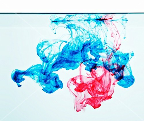Blue and red ink in water