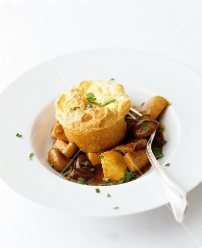 Cheese muffin with mushroom sauce