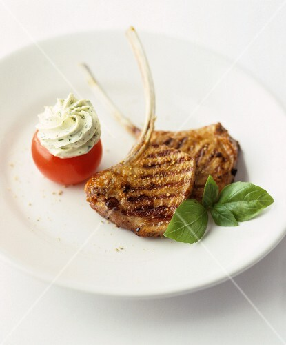 Grilled pork chops with a stuffed tomato