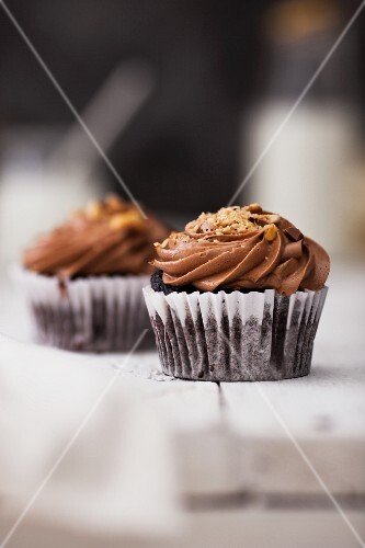 Nutella Cup Cake garnished with hazelnuts