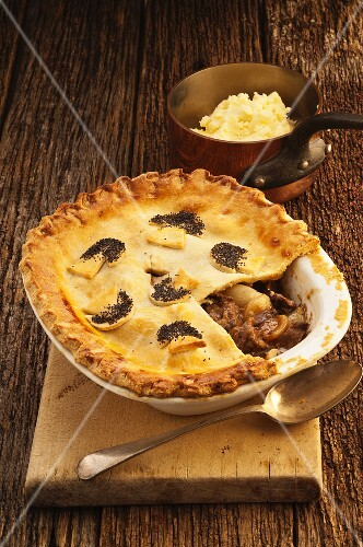 Beef and Guinness pie, cut to show the filling (England)