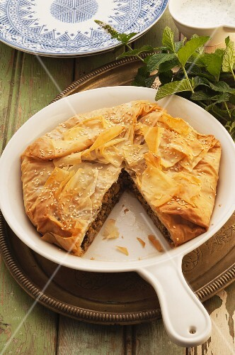 Moroccan lamb pie, one slice removed