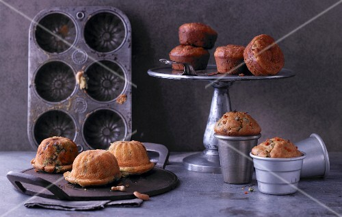 Three varieties of cupcake: spinach and Gorgonzola cakes, brown shrimp and dill cakes, and vegetable and walnut cakes