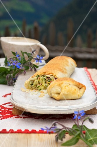 Vegetable strudel with cheese sauce