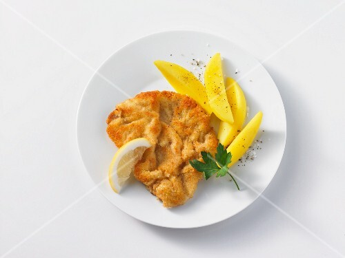 Breaded pork schnitzel with boiled potatoes