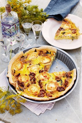 Seafood quiche with lobster, one slice cut