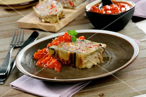 Meatloaf wrapped in aubergine with tomato sauce