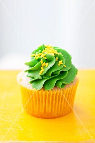 Orange cupcake with lime icing
