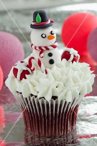 Red Velvet cupcake with cream cheese frosting and a snowman