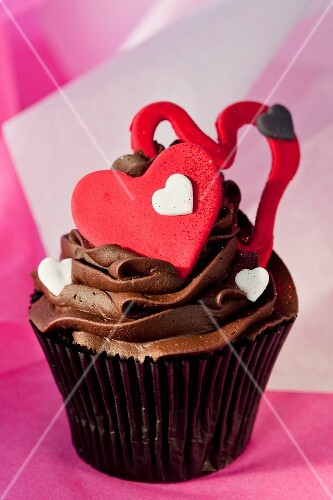 Chocolate cupcake with ganache, buttermilk filling and red hearts