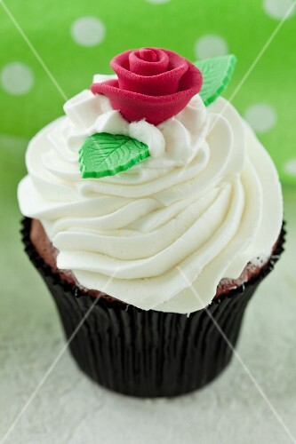 Red Velvet cupcake with cream cheese frosting and a sugar rose, for a wedding