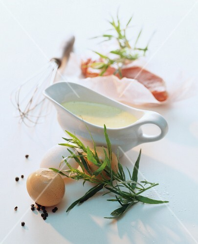 Bearnaise sauce in a sauce boat, and ingredients
